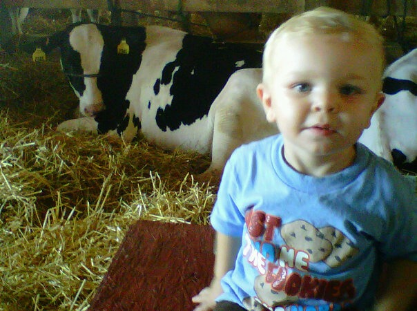 at the county fair, he was kind scared of the cows lol