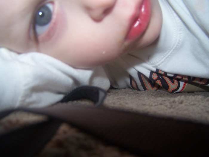 Elijah hid with the camera under the table and took a pic of himself.