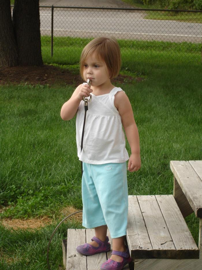 Reese singing with her dog tie out microphone.