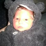 Fabian 4days old in his teddy bear suit