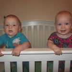 Standing for their first time in the crib...7 months.