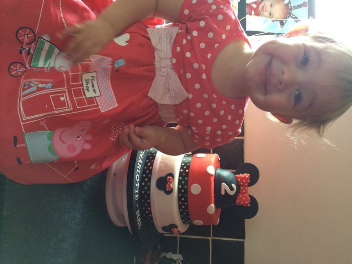 my baby with her 2nd birthday cake