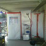 The asbestos containment and shower for the workers out the backdoor.