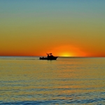 Fishing Boat Coming in After Sunset