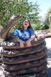 Miranda being constricted by a snake